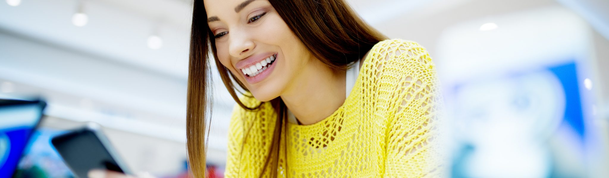 Woman smiling after memorable customer experience