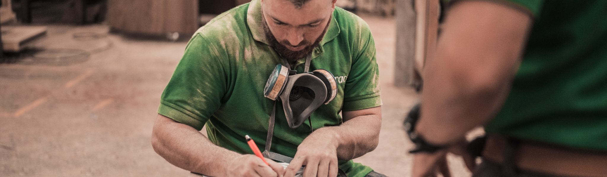 Man writing notes - manufacturing trends